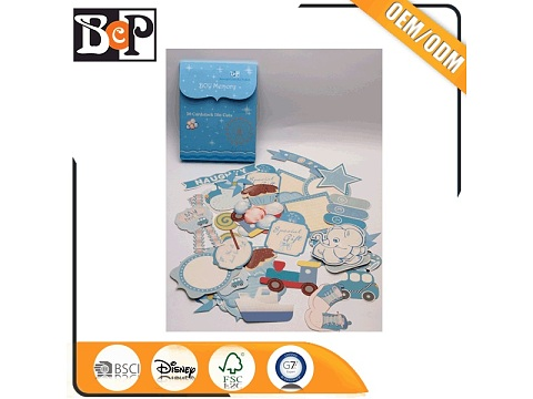 Assorted die cut chipboard kits for boy